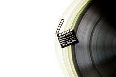 Movie clapper on 35 mm film roll isolated Royalty Free Stock Photos
