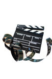 Movie clapper and 35 mm filmstrip on white Stock Images