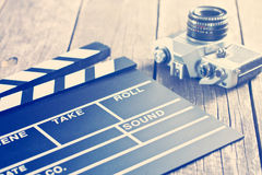 Movie clapper and old camera Stock Image