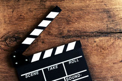 Movie clapper on old wooden background Royalty Free Stock Images