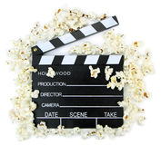 Movie clapper with popcorn Stock Images