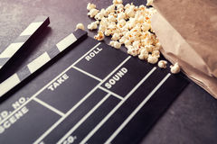Movie clapper with popcorn- time for movie Stock Image