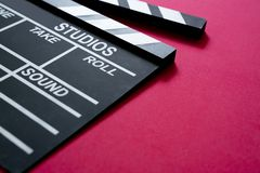 Movie clapper on red background stock image