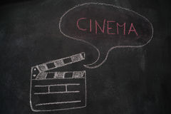 Movie clapper with speech bubble on chalkboard Stock Photo