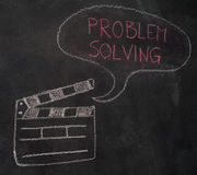 Movie clapper with speech bubble on chalkboard Stock Photography