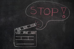 Movie clapper with speech bubble on chalkboard Stock Photos