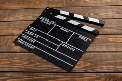 Movie clapper template on wooden backround. Movie clap clapper take action entertainment wooden background Stock Images