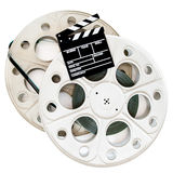 Movie clapper on two 35 mm cinema reels with film isolated Royalty Free Stock Images