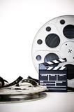 Movie clapper and vintage 35 mm film cinema reel on white Stock Photo