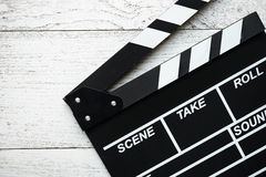 Movie clapper on wood table Stock Photos