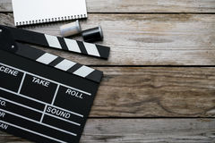 Movie clapper on wood table Stock Image