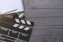 Movie clapper on wood table Stock Photography