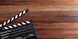Movie clapper on wooden surface. 3d illustration. Movie clapper on wooden background. 3d illustration Stock Images