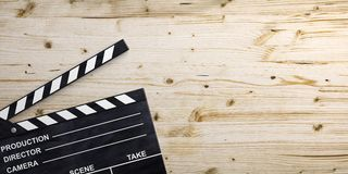 Movie clapper on wooden surface. 3d illustration. Movie clapper on wooden background. 3d illustration Stock Photo