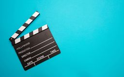 Movie clapperboard on blue color background, top view royalty free stock image