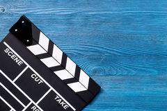 Movie clapperboard on blue wooden table background top view copyspace Stock Photography