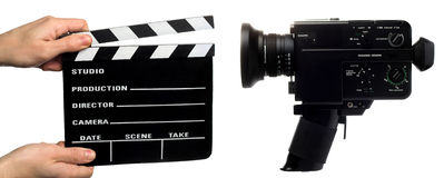 Movie clapperboard and camera Stock Images