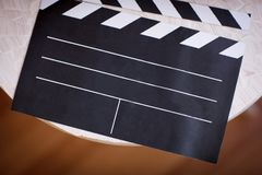 Top view of movie clapperboard on wooden table background stock photo