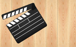 Movie clapperboard on wooden plank table. Movie clapperboard on wooden plank background Royalty Free Stock Image