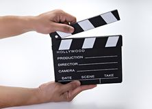 Movie clip. Closed cinema slate. Customizable and  over white, camera, clapboard, clip, video, clapperboard, footage, take, roll, chalkboard, movie, media royalty free stock photography