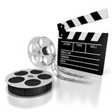 Movie concept - film. Clapperboard, film reels - great for topics like cinema/ movie theater, entertainment, movies/ films etc Royalty Free Stock Image