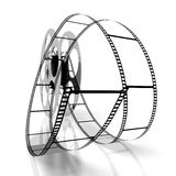 Movie concept - film reel. 3D film reel and movie tape - great for topics like cinema/ movie theater, entertainment etc Royalty Free Stock Photography