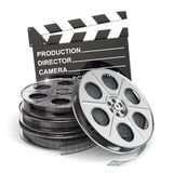 Movie concept. Film reels and clapboard. 3d Royalty Free Stock Image