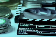 Movie cracker, rolls of film and a 35mm box films.  stock images