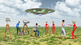 Movie crew, flying saucer and aliens Royalty Free Stock Photos
