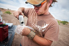 Movie Crew Member Pouring Explosive Powder Royalty Free Stock Images