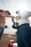 Movie Crew Tying Bags of Explosive Powder Stock Photo