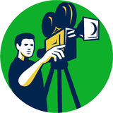 Movie Director Movie Film Camera Circle Retro. Illustration of a movie director cameraman pointing with film movie camera viewed from front set inside circle Royalty Free Stock Image