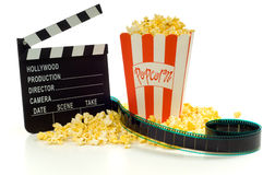 Movie, entertainment industry. Movie and entertainment industry items, including a box of popcorn a movie clapboard and a strip of 35mm film Stock Photos