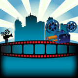 Movie festival. Abstract colorful background with filmstrip, skyscrapers and two movie projectors. Movie festival concept Royalty Free Stock Images