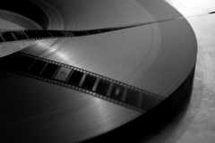 Movie Film. Movie running in a cinema projection booth Stock Images