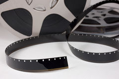 Movie film. Old 16 mm movie film and reels. Focus on foreground film Stock Photography