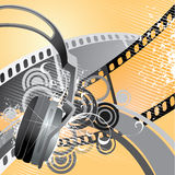 Movie/film background. Illustration of headphones and film tape; good for themes of movies or films Stock Photography