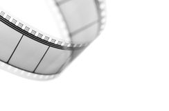 Movie film. Detail of a movie film isolated on white Royalty Free Stock Images