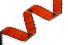 Movie film. Detail of a red movie film isolated on white Royalty Free Stock Images