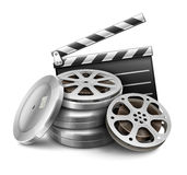 Movie film disk with tape and directors clapper for cinematography filmmaking Royalty Free Stock Image