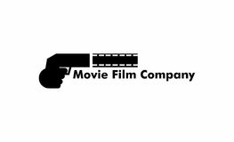 Movie film logo. A logo that depicts a hand holding a gun shooting out a movie/fim reel. Can be used for film/movie companies Stock Photo