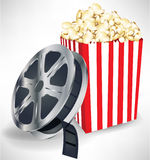 Movie film with popcorn. Movie film reel with popcorn Royalty Free Stock Photos