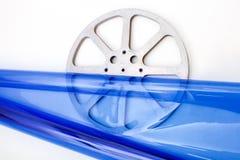 Movie film reel on blue. Movie old film reel on blue background royalty free stock photos