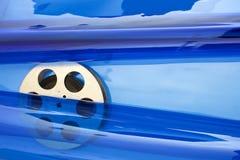 Movie film reel on blue. Movie old film reel on blue background stock images