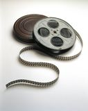 Movie film Reel & Can. A movie film reel and can with film spooling of the reels Stock Images