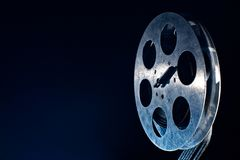 Movie film reel on dark. Movie old film reel on dark background royalty free stock photography