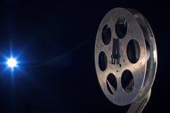 Movie film reel on dark. Movie old film reel on dark background royalty free stock photos