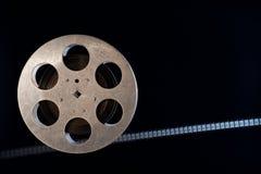 Movie film reel on dark. Movie old film 35mm reel on dark background stock photos