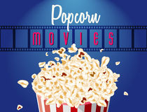 Movie film reel and popcorn Stock Photos