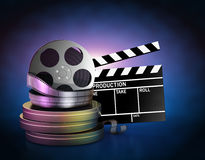 Movie film reels and cinema clapper Stock Image